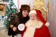 Santa and his photographer in Town Square at the Sawdust Winter Fantasy http://www.facebook.com/photo.php?fbid=10151332712426271=a.10151332712186271.522325.127022826270=1