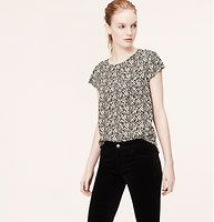 Petite Leopard Print Pocket Tee Blouse - Playfully patterned, we gave this dress-up (or down) tee style all the attitude of a blouse – with an effortlessly drapey feel. Jewel neck. Short sleeves. Chest pocket. Back keyhole with button closure. Shirttail hem.