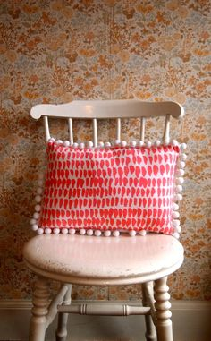 Double sided Hand Screen Printed Cushion in Linen with white extra large Pom Poms via Etsy