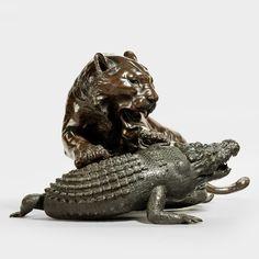 A fine Meiji bronze of a tiger and alligator, signed. (Japan)