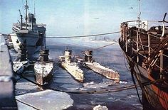 Three type VIIC-boats and the type IXA boat U 37 (second boat from the left) at the beginning of 1942 in Gotenhafen. U 37 and the VII C-boat of the 22. U-Flottille where they served as training boats for new crews. All the boats are fitted with removable ice protection structures on their bows. In the background is the ex norwegian passenger liner Vega which was used as a depot ship and had been renamed Wega by the Kreigsmarine.