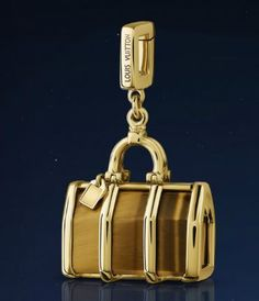 Louis Vuitton Keepall charm in yellow gold and tiger's eye