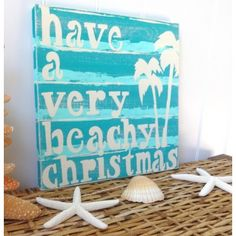 Nautical Christmas Beach Sign This would be even cuter with white twinkle lights on the palm trees! (RM)