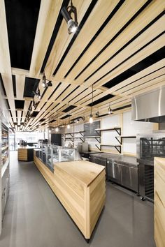 Au Pain Doré is a minimalist interior located in Montreal, Canada, designed by Naturehumaine, as a bakery that's located on the ground floor of a three-story building on Côte-des-Neiges