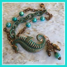"""""""Adventures In The Sea"""" Beach Jewelry Seahorse Bracelet .. A Aqua Blue Seahorse is used for the focal in this beach bracelet .. Dangling from one side are copper and glass beads .. Aqua blue and copper chain with turquoise glass beads complete this sweet bracelet .. FOR SALE $45.00 ..  https://www.etsy.com/shop/CleverDesignsbyJann"""