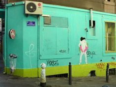 French artist Claire Thoele Streetart's wall collages depicting couples kissing in sexy and often provocative positions are sweeping the streets of France.