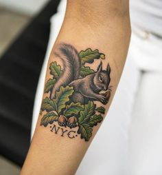 This color squirrel tattoo is pretty awesome. Wouldn't get the initials NYC. Nice forearm tattoo!
