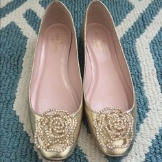 Kate Spade New York Nevella Platino Saffiano Flat Kate Spade New York Nevella Platino Saffiano Metallic Leather Flat.Embossed leather shoes with rose broach embellishment. Rose broach is adorned with crystals. Smooth leather lining. Lightly padded leather footbed. Leather outsole. Made in Italy and Imported. kate spade Shoes