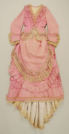 Pink silk dress with fringe trim (front, with day bodice), French, 1871.