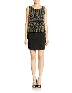 Glittering beads create a geometric pattern on the airy blouson top to this chic style, finished off with a flatteringly ruched form-fitting skirt.