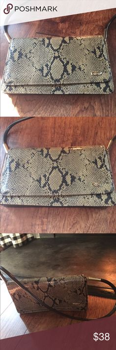 Nine West** Faux python shoulder bag Nine West** faux Python shoulder bag with silver hardware. Has a pocket in the backand two separate sections in the bag with a little zip pocket.  It's in very good condition and can be used for work or night out. Have fun with his back!! Nine West Bags Shoulder Bags