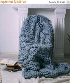 This super chunky knit blanket is perfect for everyone. It is really big and very beautiful! This blanket is extremely soft and durable.This blanket will keep you cozy when the weather turns cold, and provides a warm decorative touch to any room in your house.100% Australian merino wool knitted on giant needles. I use only natural yarn from pure fibers for my blankets!   The measurement will change within a few inches back and forth with use because of the natural shifting in the knit…