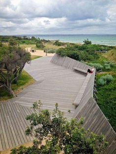Angular deck sloping into gardren bed