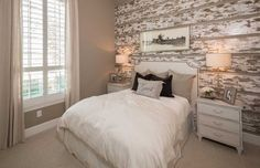 Weathered wood creates a gorgeous, rustic accent wall. Hollyhock // Frisco, TX // Highland Homes // Plan 248
