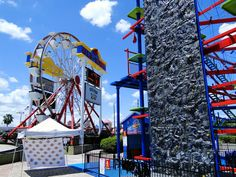 Modular Rock Climbing Panels easily attach to any existing structure. Here is a climbing wall / high ropes course combo.