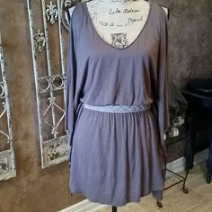 """NWT Free People """"teak""""  tunic S NWT teak tunic with flutter sleeveless sides and braided illusion belt. Size S ... fits up to M   $50 Trade Value Free People Tops Tunics"""