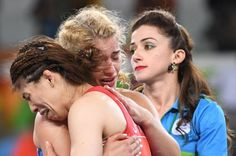 Japanese wrestling legend Saori Yoshida (front) embraces her vanquisher, Helen Maroulis, after their championship bout.