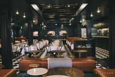 Finca restaurant in downtown Salt Lake City, Utah. Design by Cody Derrick and Lauren Bald of cityhomeCOLLECTIVE. #custom #sofa #brown #leather #marble #table #teal #art #checkerboard #tile