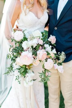 Gorgeous wild blush, peach and white bouquet by Carte Blanche Floral Design.  Romantic blush backyard Arizona garden wedding by Pinkerton Photography, Arizona Wedding Photographer.