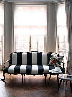 I'm dying for this settee!!  The black and white stripes are the perfect touch to modernizing this classic.