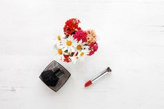 makeup brush and cosmetics by huertas19 on Creative Market