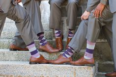 The groomsmen wore purple, pink & gray argyle and striped socks to match the purple wedding. LOVE this idea! {Turnquist Photography}