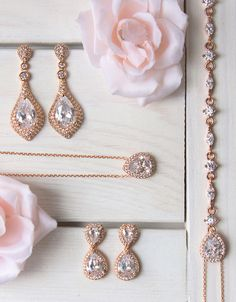 PRODUCT DETAILS: - 18K Rose Gold Vermeil - Cubic Zirconia Crystals - Lobster clasp - Front Necklace: chain length 16 in (40.6 cm), Pendant 1 in (2.5 cm) x W 0.5 in (1.3 cm) - Back Pendant: Tear Drop W