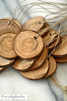 """Gift tags cut from small dead log, hole drilled and strung w jute. Love! Diana is so clever w wood. Hurray for """"vintage home"""" blog."""