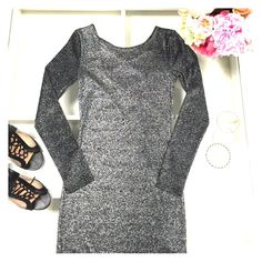 Black and silver dress Black long sleeve dress - sparkly! (Not glitter but silver thread) Crisscrosses in the back. Divided Dresses Mini