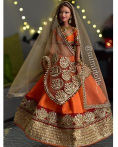 Orange, gold and maroon traditional Indian outfit for a regular body type barbie and similar sized dolls. Barbie Doll Set, Doll Clothes Barbie, Vintage Barbie Dolls, Barbie Dress, Stylish Dress Designs, Stylish Dresses, Shagun Blouse Designs, Barbie India, Barbie Bridal