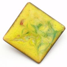 enamel brooch - square, scrolled green and red on yellow £7.50