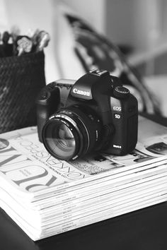 <3 Canon camera on black and white.  { I know don't really need but so COOL}