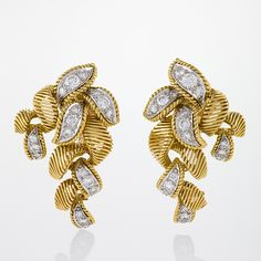 Van Cleef & Arpels Mid-20th Century Diamond and Gold Earrings by George Len Font.