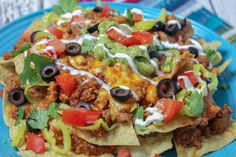 Make the layered nachos recipe so good it earned a Blue Ribbon from our test kitchen. This quick and easy meal is a fun dinner recipe, but it would also be great for game day. Great Appetizers, Appetizer Recipes, Delicious Appetizers, Mexican Food Recipes, Ethnic Recipes, Mexican Meals, Filipino Recipes, Mexican Dishes, Best Dinner Recipes