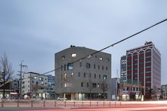 The first strategy was to construct a building that is small, since it is located on the roadside, yet has a presence. For this, we set the side facing the road not to be the mass but the urban wall reacting to the city. The second was to break from the general simple core structure of a commercial building and create an open type of circulation path, where the characteristics of the building users are shown, and the exchange between each other is possible.