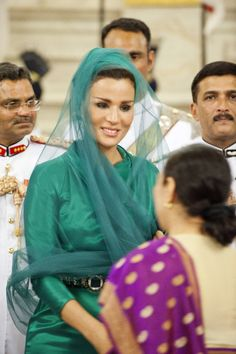 Sheikha Mozah was the definition of royal elegance in green Dior Haute Couture gown at the State Visit dinner to India in 2012. This look was unique and mysterious in way, she added th veil and it looks effortless. Photo credit to HHOPL.