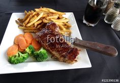 New York sirloin steak with French fries and vegetables.