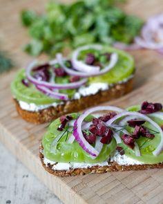 Green Tomato Tartines - crusty bread,   goat cheese, green tomatoes, red onion, kalamata olives, fresh dill, olive oil   kosher salt