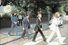 Photo shoot of famous Abby Road album cover. John, Ringo, Faul & George.