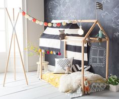 If you've already tackled the first DIY from our Fall Hanna Home shoot than you might be ready for something a little bit more labor-intensive. Our prop stylist Dane has an extra special project up his sleeves for you: A Playhouse Toddler-Size Bed Frame!Not for the tool-averse, this project offers