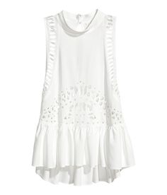 Check this out! Sleeveless top in woven viscose fabric with cutwork embroidery. Small stand-up collar, racer back, and opening with button at back of neck. Deep armholes. - Visit hm.com to see more.