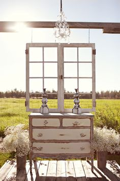A vintage dresser and windows creates this beautiful outdoor/indoor ceremony site. You can dress it up with flowers or leave it as is. Credit: loveandlavender.com #weddingaltar #vintageweddings
