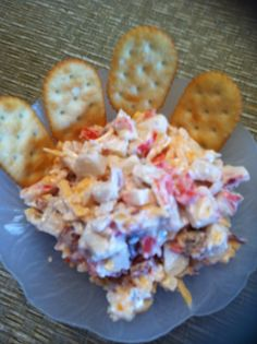 Mock Crab Dip Recipe: 1 PKG mock crab, 1/2 cup shredded cheddar cheese, 3 pieces bacon crumbled; 2 tbls finely chopped onion; 3 tbls chopped fresh tomato, 2 tbls  Miracle Whip; 2 tbls Hellman's mayonnaise Mix all ingredients, serve on crackers.  Delicious!