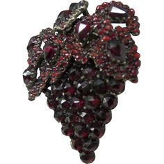 This 145 year old Garnet pin is absolutely fabulous. It is designed as a bushel of grapes with the multi leaves draping over them on the upper
