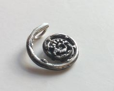 As it uncurls in the springtime, this silver fiddlehead fern has a deep three dimensional texture, oxidized in the grooves and shiny on the high spots. I was very happy with how the details turned out in this casting, created from a deer fern. It is made of solid sterling silver, cast from a real fern, one of a kind. It is available with or without a sterling silver chain in the length of your choice. The snake chain in the photos is 16 inches long. Chain style may vary in other lengths…