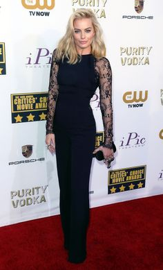Margot Robbie wears a lace sleeved black Elie Saab jumpsuit and Alexander McQueen clutch #CriticsChoiceAwards