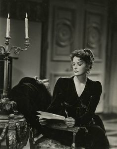 Greta Garbo, asCountess Marie Walewska, reads inConquest, 1937. Photographby Clarence Sinclair Bull.Marie, a Polish countess, is dispatched by her country to meet with Emperor Napoleon Bonaparte (Charles Boyer). Marie has been encouraged to press for Polish independence by whatever means possible–and though no one comes out and says as much, it is understood that she will offer herself sexually to the promiscuous Napoleon.