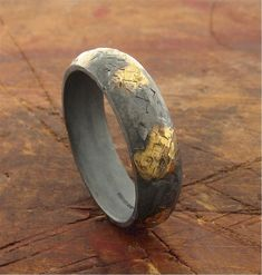 rustic wedding rings Mans rustic wedding band in black silver and gold, wide handmade mens wedding ring with hammered surface mens wedding band Rustic Wedding Bands, Handmade Wedding Rings, Wedding Ring Designs, Black Gold Wedding Rings, Platinum Wedding Rings, Rings For Men, Black Silver, Surface, Unique Presents