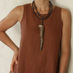 Pendant Necklace made of polished horn  and ethnic beads built on leather cord