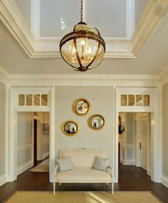 8 Secrets to Having a Gorgeous Entrance Foyer - laurel home | gorgeous entry and architecture by Austin Patterson Disston Architects | lovely pale gray walls and cream trim - could be Benjamin Moore Classic Gray 1548 and Ivory White 925